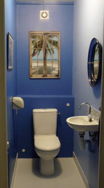 Tableau déco dans les toilettes WC